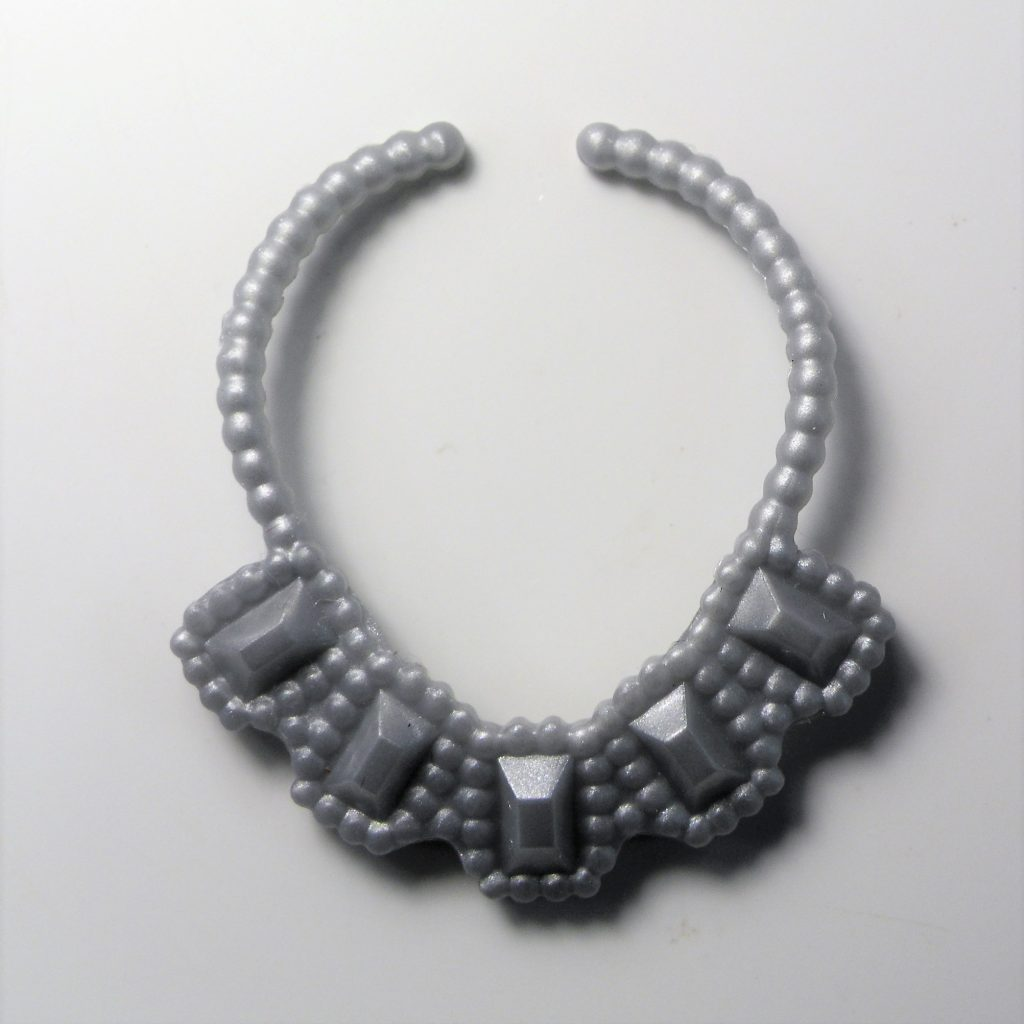The silver necklace detail